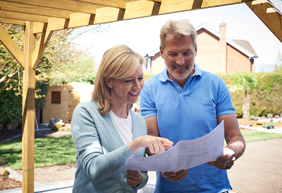 Two people looking at house plans