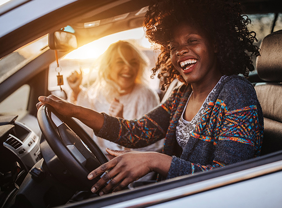 Two people smiling in a car