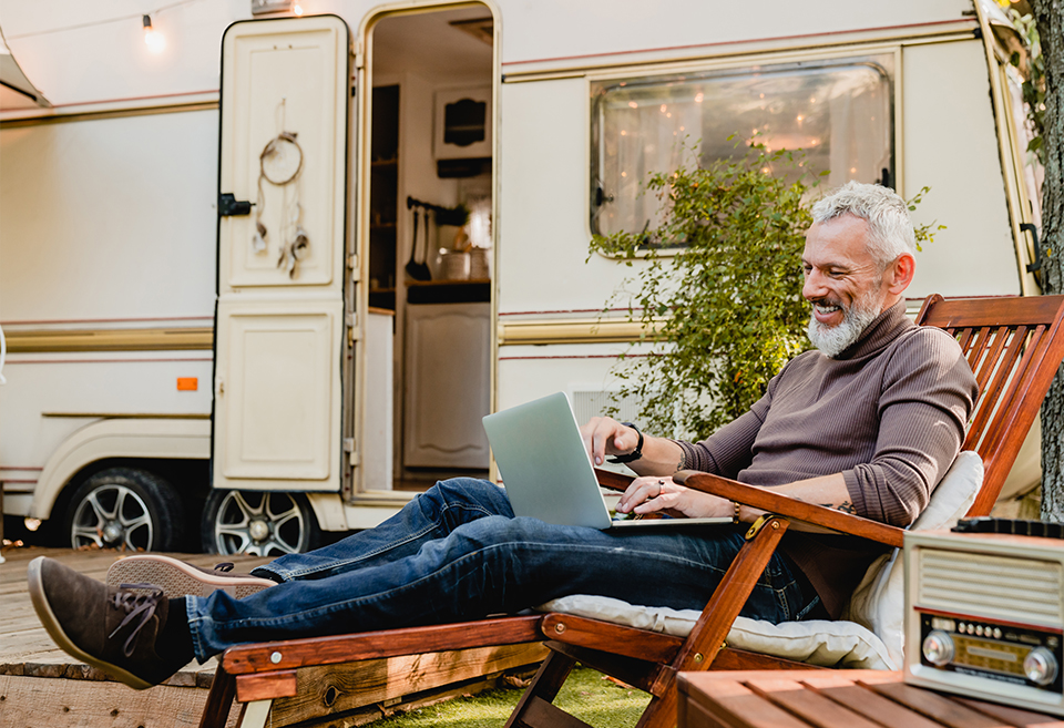 Person sitting outside an RV
