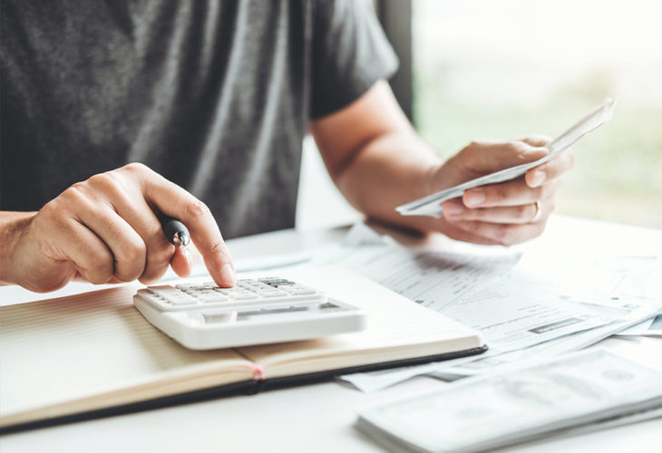 Person getting their finances in shape using this helpful checklist