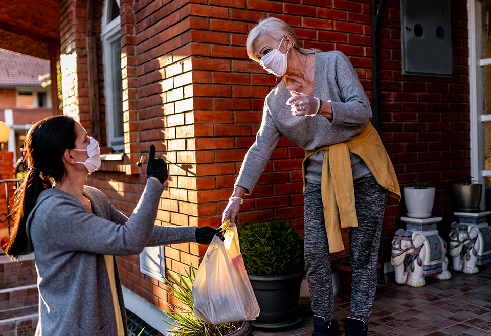 Volunteer delivering food to a neighbor during the pandemic