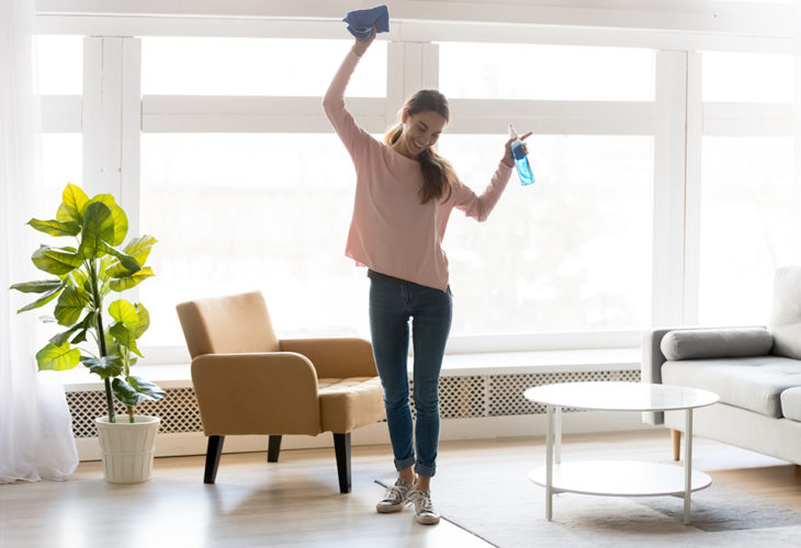 Woman spring cleaning her finances