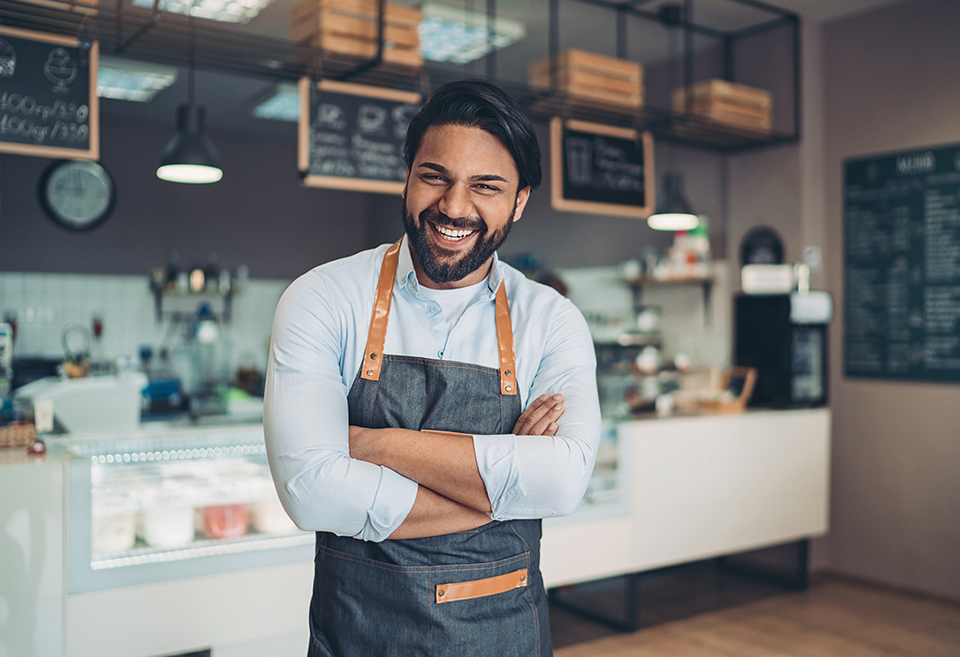 Coffee shop worker smiling