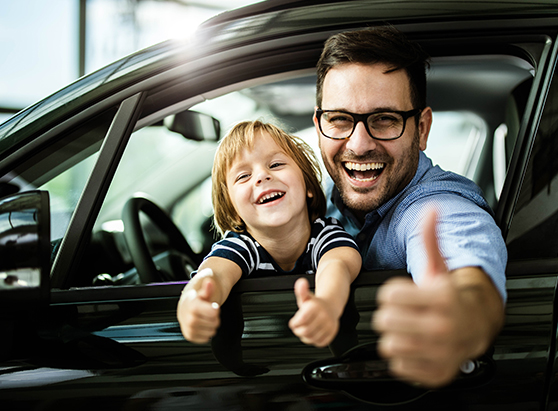 Adult and child smiling in car