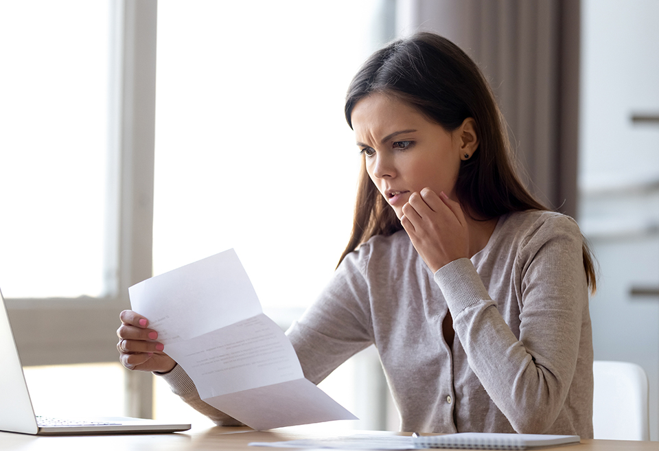 Woman opening scam letter